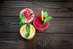 Assorted fruit smoothies on a wooden table Stock Image