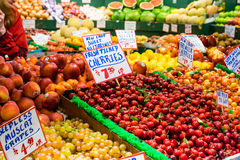 Assorted fruit stand, indoor market Stock Image