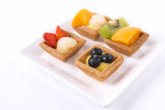 Assorted fruit tarts on plate - series 2 Royalty Free Stock Photos