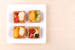 Assorted fruit tarts on plate - series 5 Royalty Free Stock Photo