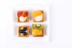 Assorted fruit tarts on plate Stock Photography