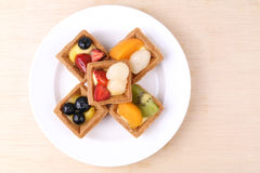 Assorted fruit tarts on round plate - Series 3 Stock Images
