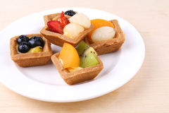 Assorted fruit tarts on round plate - Series 4 Stock Photos