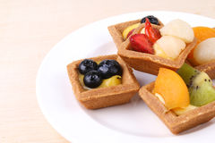 Assorted fruit tarts on round plate - Series 5 Royalty Free Stock Images