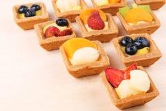 Assorted fruit tarts Stock Photos