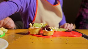 Assorted fruit on wooden board. Fruits on plate on wooden surface. Bananas, apples , pineapple, oranges. Assorted fruits on the plate. Flat lay. Vegan. Healthy stock video