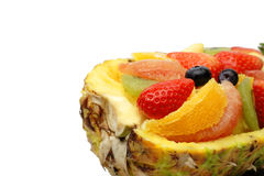 Assorted fruits. Assorted exotic fruits in a pineapple skin-over white background Royalty Free Stock Photos
