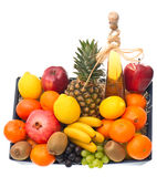 Assorted fruits and bottle of wine Stock Photos