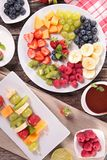 Assorted fruits and dip Stock Image
