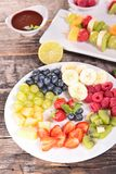 Assorted fruits and dip Royalty Free Stock Photo