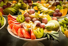 Assorted fruits of grapes, kiwi, oranges Stock Photos