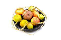 Assorted fruits with measuring tape Stock Image