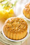 Assorted fruits nuts mooncakes on table Royalty Free Stock Photos