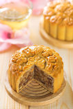 Assorted fruits nuts mooncakes with tea Stock Image