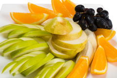 Assorted fruits of orange, apple, grapes, pear Stock Photography