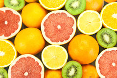 Assorted fruits. Assorted oranges, tangerines, kiwi and other fruits Royalty Free Stock Photo