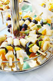 Assorted fruits on skewers Royalty Free Stock Photos