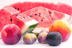 Assorted fruits, slices of watermelon, peach, fig, plum, apple Royalty Free Stock Images