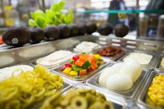 Assorted fruits and vegtables for making salads. And sandwiches stock photography
