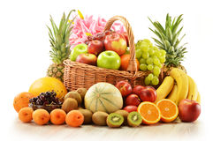 Assorted fruits in wicker basket  on white Stock Images