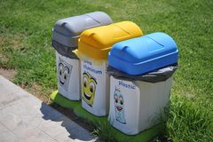Assorted Garbage Cans. Three different ecological garbage cans for separation of plastic, metal and degradable waste Royalty Free Stock Photos