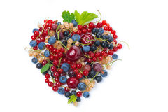 Assorted garden berries in a heart-shaped, top view, isolated Stock Photos