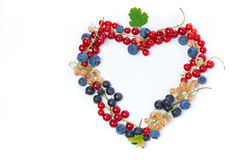 Assorted garden berries in a heart-shaped, top view, isolated Royalty Free Stock Photography