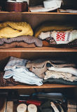 Assorted Garments on Brown Wooden Wardrobe Stock Image