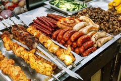 Assorted German sausages grilled in a steel container Stock Images