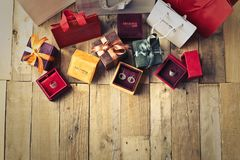 Assorted Gift Boxes on Brown Wooden Floor Surface Stock Photos