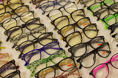 Assorted glasses at apparel and accessory shop. Cheap apparel. And high quality fashion at discounts and promotions royalty free stock images