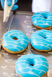 Assorted glazed doughnuts in different colors Royalty Free Stock Photos
