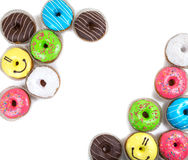 Assorted glazed doughnuts in different colors Royalty Free Stock Images