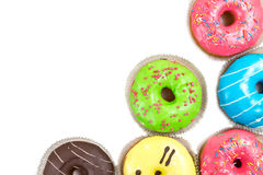 Assorted glazed doughnuts in different colors Stock Image