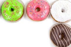Assorted glazed doughnuts in different colors Royalty Free Stock Photography