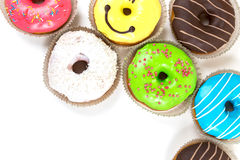 Assorted glazed doughnuts in different colors Royalty Free Stock Image