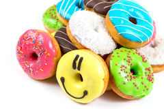 Assorted glazed doughnuts in different colors Stock Photos