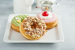 Assorted glazed fried donuts on a plate Stock Image