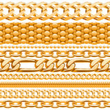 Assorted golden chains on white. Royalty Free Stock Image