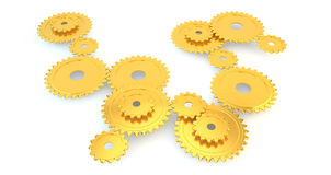Assorted Golden Metal Gears. Shiny golden gears in many sizes, isolated Royalty Free Stock Image