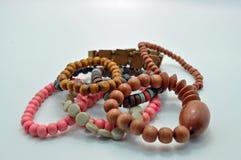 Assorted goteó la joyería de madera de las pulseras Imagen de archivo libre de regalías