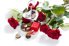 Assorted gourmet chocolate and bouquet red roses Royalty Free Stock Images