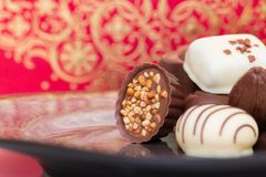 Assorted gourmet chocolate candies in the dish. stock photo