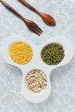 Assorted grains and wooden spoon Royalty Free Stock Images