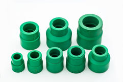 Assorted green PVC pipe fittings Royalty Free Stock Image