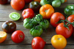 Assorted green and ripe tomatoes on boards Royalty Free Stock Photo