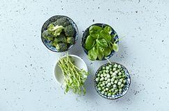 Assorted green vegetables and sprouts for cooking and salads stock photos