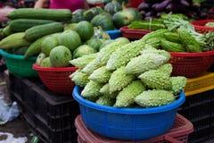 Assorted green vegetables Vietnamese farm market Royalty Free Stock Image