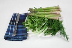 Assorted greens and vegetable. Isolated on white with napkin and knife aside Stock Image
