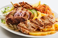 Assorted grilled meat with chips and salad stock photo